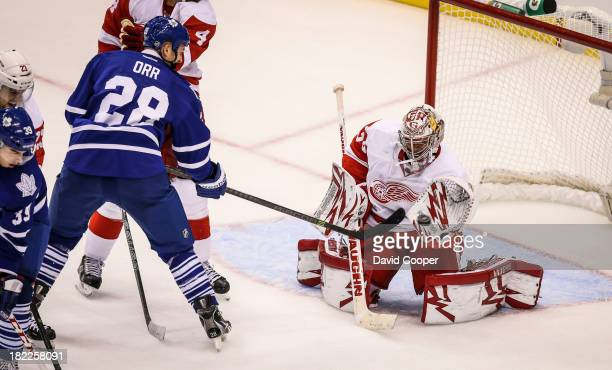 TORONTO ON SEPTEMBER 28 Toronto Maple Leafs right wing Colton Orr tries to get the puck past Detroit Red Wings goalie Petr Mrazek as the Toronto...