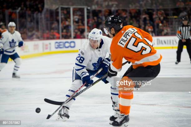 Toronto Maple Leafs Right Wing Connor Brown and Philadelphia Flyers Center Valtteri Filppula fight for possession in the second period during the...