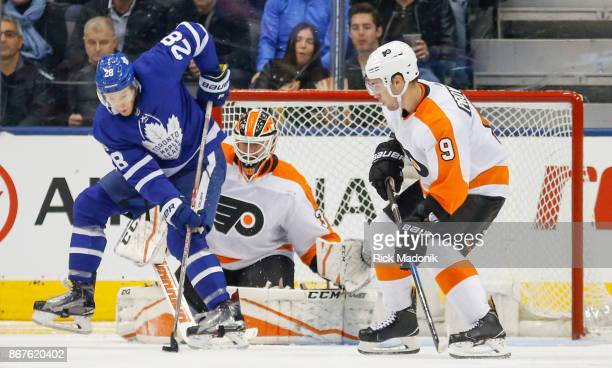 Toronto Maple Leafs right wing Connor Brown can't get good control of the puck in front of Philadelphia Flyers goalie Brian Elliott as Philadelphia...