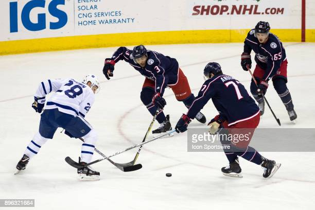 Toronto Maple Leafs right wing Connor Brown Columbus Blue Jackets defenseman Seth Jones and Columbus Blue Jackets right wing Josh Anderson battle for...