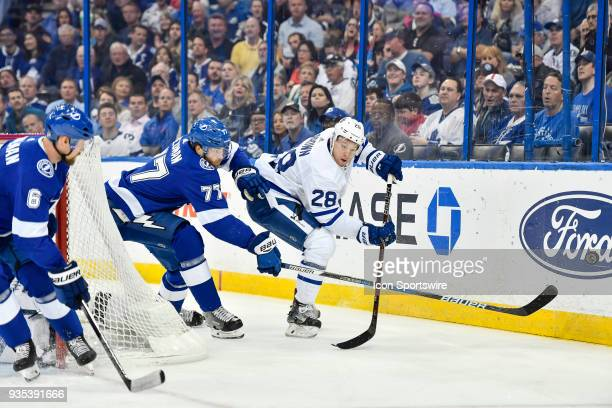Toronto Maple Leafs right wing Connor Brown has his centering attempt poked away by Tampa Bay Lightning defender Victor Hedman during the first...