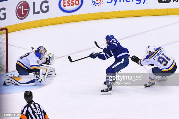 Toronto Maple Leafs Right Wing Connor Brown scores on St Louis Blues Goalie Carter Hutton as Right Wing Vladimir Tarasenko trails the play during the...