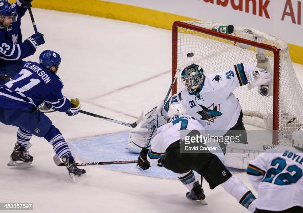TORONTO ON DECEMBER 3 Toronto Maple Leafs right wing David Clarkson fails to put the puck in the net past San Jose Sharks goalie Antti Niemi as the...
