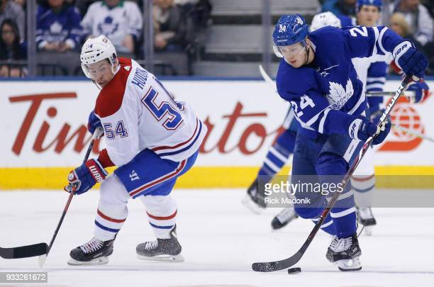 Toronto Maple Leafs right wing Kasperi Kapanen takes control of the puck as Montreal Canadiens left wing Charles Hudon looks back Toronto Maple Leafs...