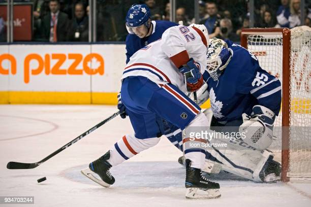 Toronto Maple Leafs Right Wing Mitchell Marner and teammate Goalie Curtis McElhinney keep a loose puck away from Montreal Canadiens Right Wing...