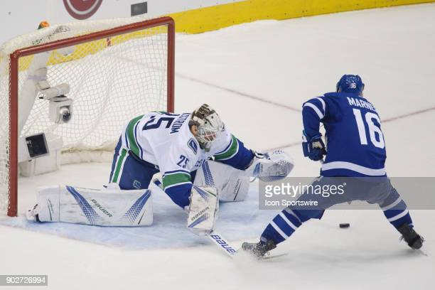Toronto Maple Leafs Right Wing Mitchell Marner comes in with the puck on Vancouver Canucks Goalie Jacob Markstrom during the regular season NHL game...