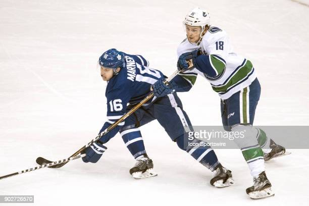 Toronto Maple Leafs Right Wing Mitchell Marner is checked by Vancouver Canucks Right Wing Jake Virtanen during the regular season NHL game between...