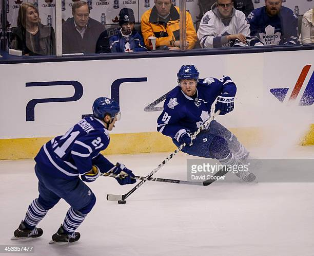 TORONTO ON DECEMBER 3 Toronto Maple Leafs right wing Phil Kessel oos to pas the puck as the Toronto Maple Leafs take on the San Jose Sharks at the...