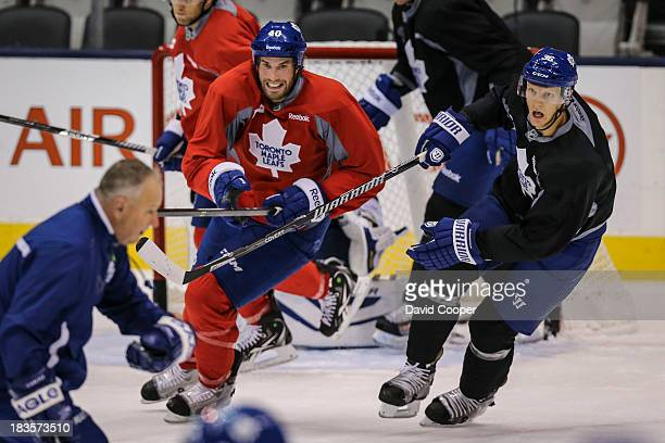 TORONTO ON OCTOBER 7 Toronto Maple Leafs right wing Troy Bodie and defenseman Carl Gunnarsson skate hard late in the practice with his team mates at...