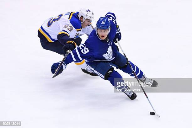 Toronto Maple Leafs Right Wing William Nylander is chased by St Louis Blues Left Wing Dmitrij Jaskin during the regular season NHL game between the...