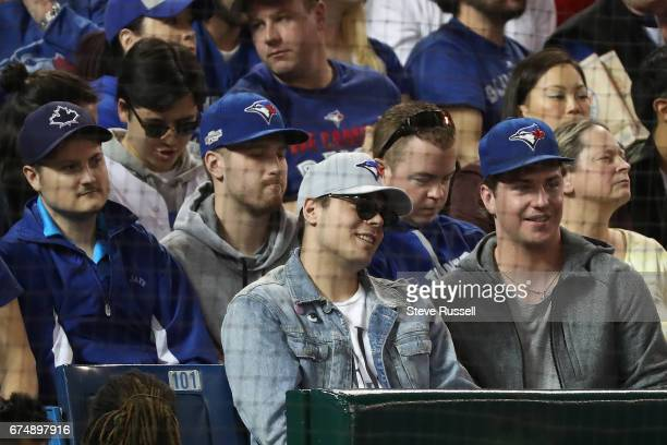 TORONTO APRIL 29 Toronto Maple Leafs rookie Auston Matthews grey hat take in the game as the Toronto Blue Jays beat the Tampa Bay Rays 41 at the...