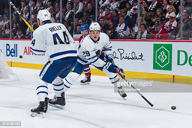 Toronto Maple Leafs Winger William Nylander trying to get to the puck and avoiding collision with Toronto Maple Leafs Defenceman Morgan Rielly during...