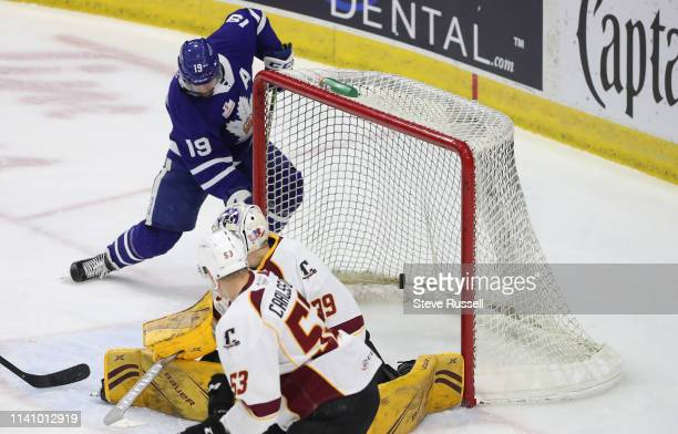 TORONTO ON MAY 3 Toronto Marlies center Chris Mueller scores the game's first goal as the Toronto Marlies play the Cleveland Monsters in game two of...