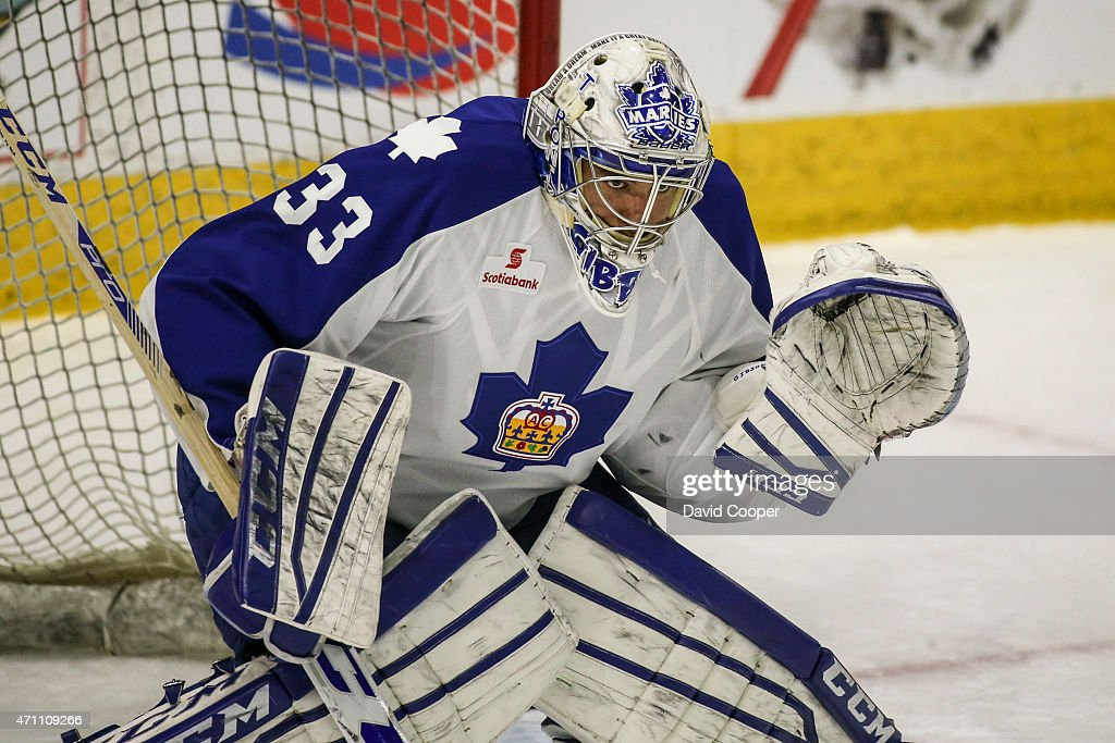 TORONTO, ON- APRIL 25 - Toronto Marlies goalie Christopher Gibson (33) tracks the puck before the first game of the AHL playoffs for the Calder Cup between the Toronto Marlies and the Grand Rapids Griffins at the Ricoh Coliseum April 25, 2015