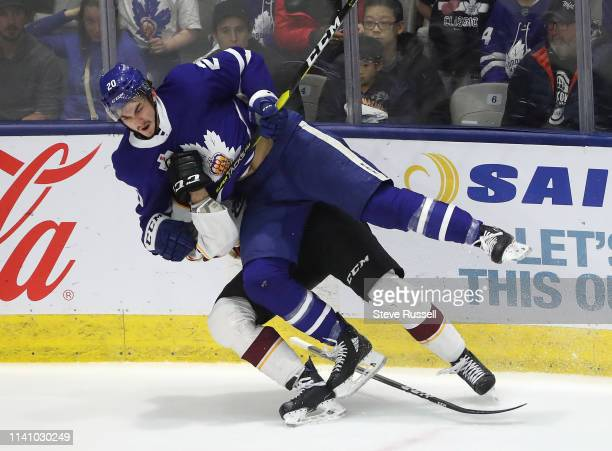 Toronto Marlies left wing Mason Marchment checks Cleveland Monsters center Mark Letestu as the Toronto Marlies play the Cleveland Monsters in game...