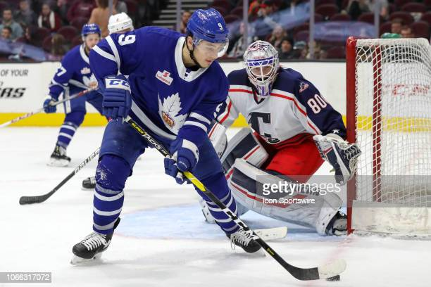 Toronto Marlies left wing Trevor Moore plays the puck in frnt of Cleveland Monsters goalie Matiss Kivlenieks during the third period of the American...