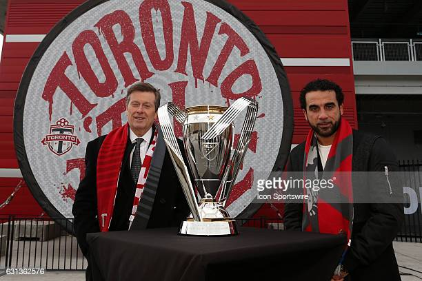 Toronto mayor John Tory and Canadian soccer legend Dwayne De Rosario pose with the trophy Major League Soccer's Philip F Anschutz Trophy made an...