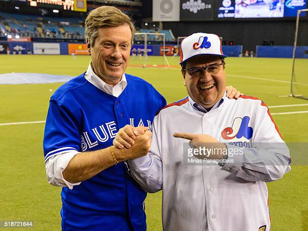Toronto Mayor John Tory and Montreal Mayor Denis Coderre pose for photos prior to the MLB spring training game between the Toronto Blue Jays and the...