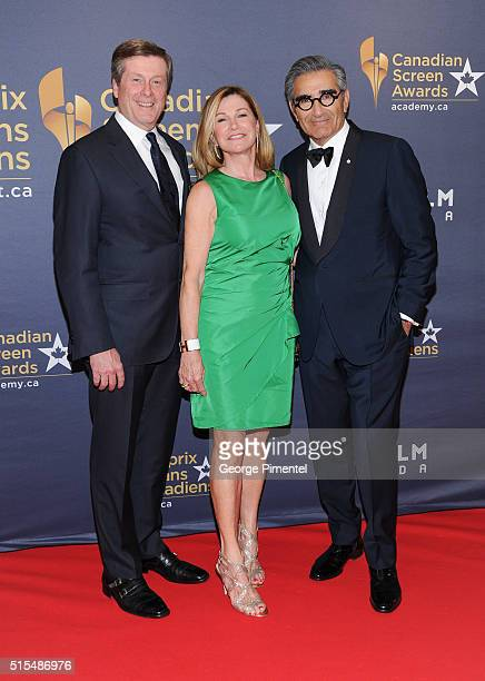Toronto Mayor John Tory Barbara Hackett and actor Eugene Levy arrive at the 2016 Canadian Screen Awards at the Sony Centre for the Performing Arts on...