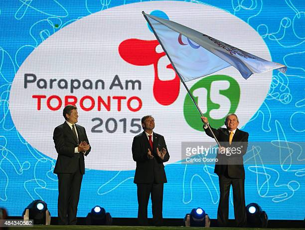 TORONTO ON AUGUST 15 Toronto Mayor John Tory passes the Paralympic flag to Luis Campo during the Closing Ceremonies of the 2015 Toronto Para Pan AM...