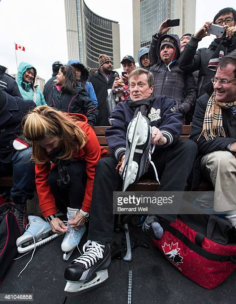 Toronto Mayor John Tory puts on skates with his wife Barbara Hackett at Nathan Phillips Square on New Year's Day January 1 2015