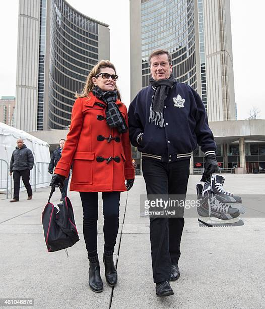 Toronto Mayor John Tory walks to the rink with his wife Barbara Hackett at Nathan Phillips Square on New Year's Day January 1 2015