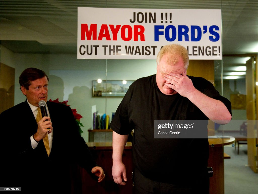 Toronto Mayor Rob Ford Is Seen On A Scale Outside His Office At City Hall During