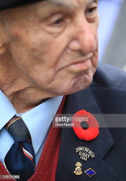 PM Toronto Mayor Rob Ford looks at some of the medals on DDay veteran Weldon Clark before reading a proclamation in remebrance of DDay Today media...