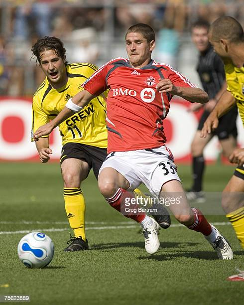 Toronto midfielder Carl Robinson chases the ball ahead of the pursuit of Crew midfielder Ned Grabavoy on the road against the Columbus Crew on July...