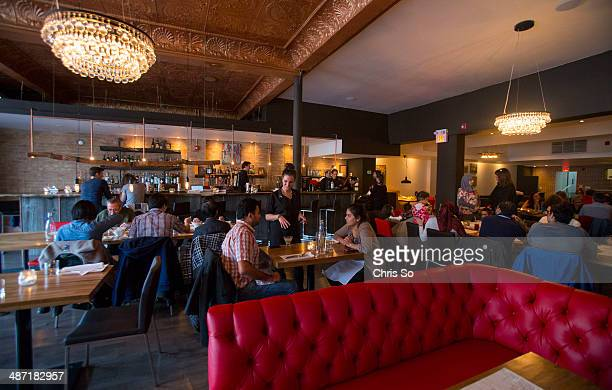 Toronto ON APRIL 18 2014 The District Oven dining area is flanked by tufted red booths and the bar The restaurant is located on College St at...