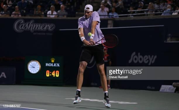 Toronto, ON- August 14 - John Isner returns a serve on the backhand. Daniil Medvedev of Russia beats John Isner of the USA 6-2, 6-2 in the semifinals...