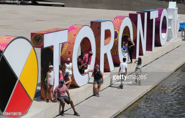 Toronto, ON- August 16 - People gather at Nathan Phillips Square. Ontario remains in stage three of reopening as COVID-19 cases rise in a fourth...
