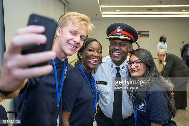 JULY 19 The first community meeting on the Toronto police plan for modernizing the police service Police Chief Mark Saunders takes a selfie with...