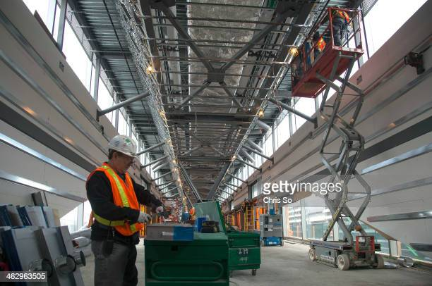 Toronto ON JANUARY 15 Heating Ventilating and Air Condition contractors install HVAC ducting in the Union Pearson Express air rail train terminal at...