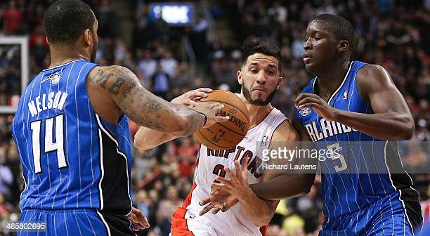 Toronto ON January 29 In second half action Toronto Raptors point guard Greivis Vasquez tries to drive to the hoop but Orlando Magic point guard...