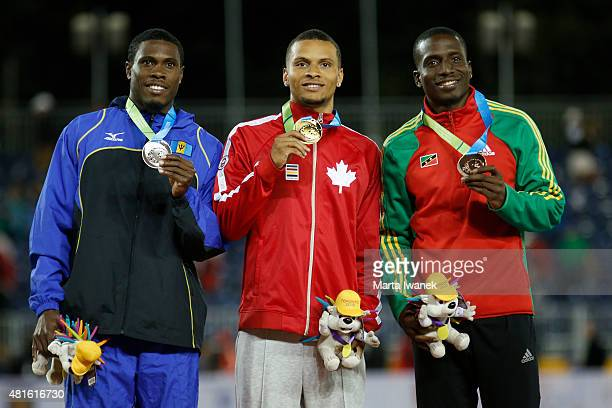 Toronto On JULY Ramon Gittens won silver Canada's Andre De Grasse gold and Antoine Adams SKN won bronze at the 2015 Pan Am men's 100m final on July...