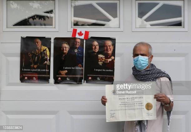 Toronto, ON- June 7 - Mohamad Haniff holds his Ryerson diploma, as more protests erupt for the 215 indigenous children found in a former Kamloops...