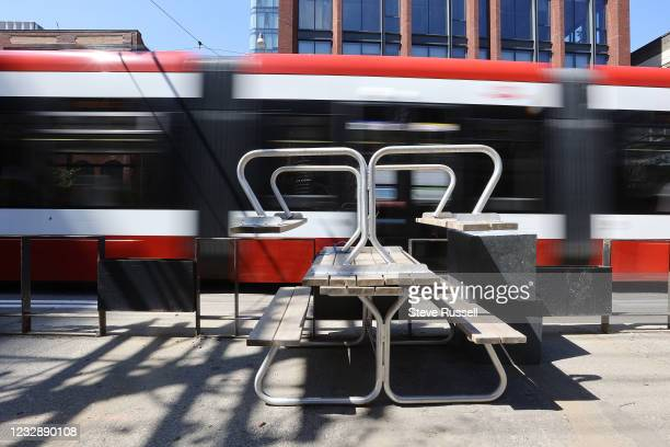 Toronto, ON- May 14 - Patios along King Street West sit vacant due to COVID-19 restrictions on a warm sunny day. Many restaurants that are confused...