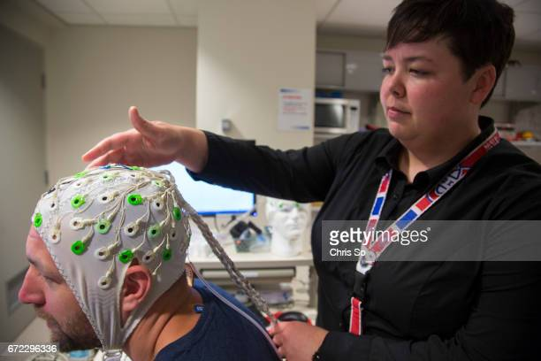 TORONTO ON Toronto ON MAY 26 2014 Former NHL player Bryan Muir has an EEG cap adjusted by concussion researcher Dr Carrie Esopenko The covering has...