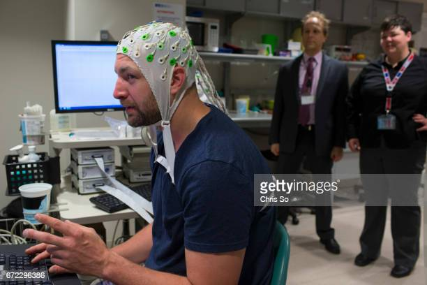 TORONTO ON Toronto ON MAY 26 2014 Former NHL player Bryan Muir undergoes some brain teaser tests while researchers Dr Brian Levine center and Dr...