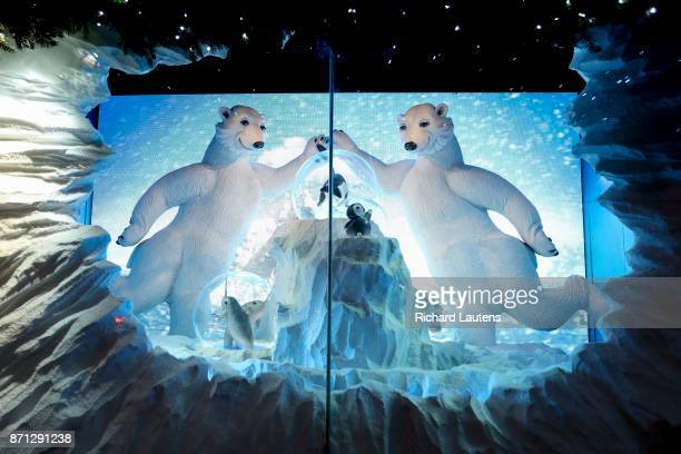 Toronto ON NOVEMBER 6 One of the 5 snow globe themed windows is Arctic Adventures Two polar bears meet for a celebratory highfive in an arctic scene...