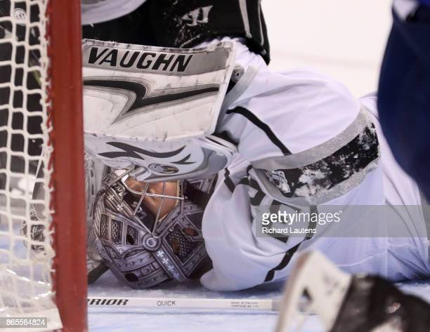 Toronto ON OCTOBER 23 In first period action Los Angeles Kings goalie Jonathan Quick holds his head after a collision and briefly left the game under...
