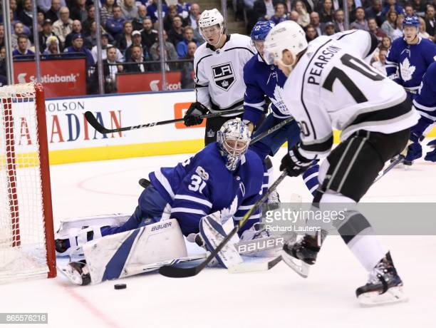 Toronto ON OCTOBER 23 In second period action Toronto Maple Leafs goalie Frederik Andersen makes a big save on Los Angeles Kings left wing Tanner...