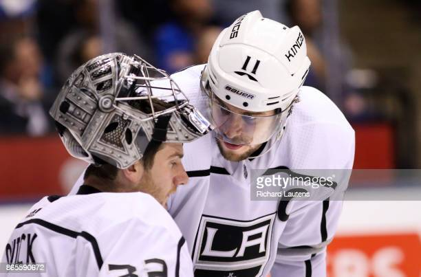 Toronto ON OCTOBER 23 In third period action Los Angeles Kings center Anze Kopitar has a quiet chat with goalie Jonathan Quick The Toronto Maple...