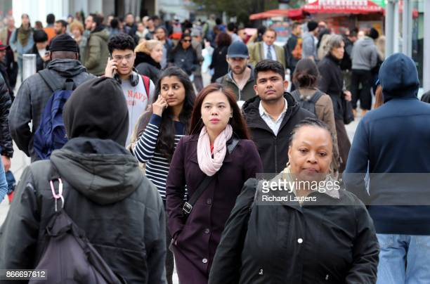 Toronto ON OCTOBER 25 Crowds cross the street at Yonge/Dundas square Most people in Canada's biggest city now identify as visible minorities as new...