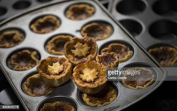 Toronto Ontario JUNE 17 2014 Kyla Eaglesham owner of Madeleines baked goods whips up a batch of yummy maple butter tarts using amber maple syrup from...