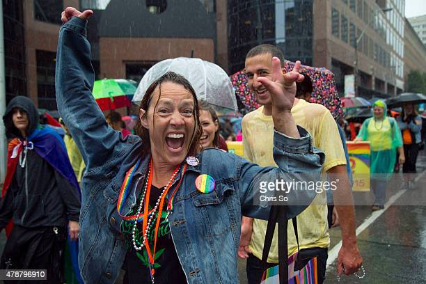 Toronto Ontario JUNE 27 2015 Donna Swayze of Welland Ontario dances near the start of the parade Participants in the Toronto Dyke March did not let...