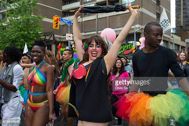 Toronto Ontario JUNE 28 2015 Pride parade participants strut their colorful costumes as they make their way down Yonge Street during the 2015 Toronto...