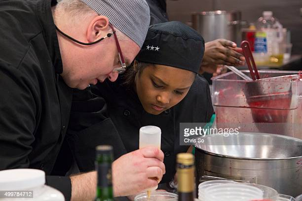 Toronto Ontario MARCH Chef culinary instructor Keith Hoare of Thistletown Collegiate show his student gr 11 Justice Chea a sauce experiment Hoare's...