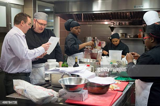 Toronto Ontario MARCH Chef House restaurant dining room technologist Dave Schwingenschloegl left checks the menu with Chef culinary instructor Keith...